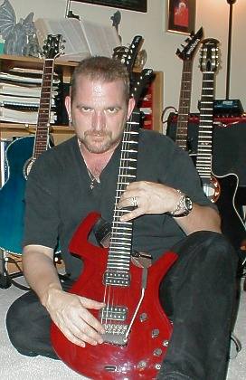 Craig with red guitar